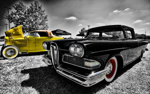 Edsel cars - black and white photo with yellow and red highlights