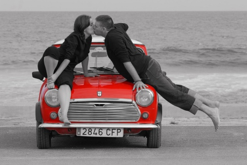Couple kissing on red mini