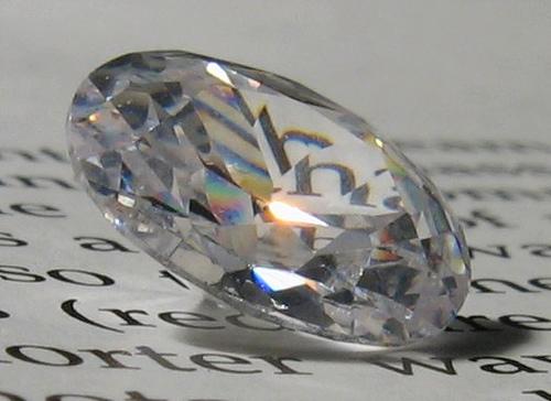 Diamond sitting on written page